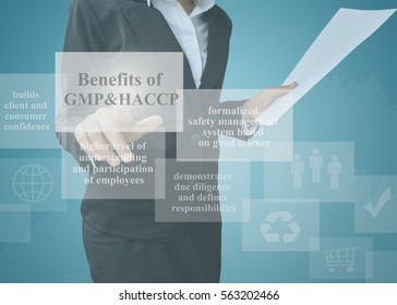 Businesswoman showing presentation benefits of GMP & HACCP concept for used in company and training.