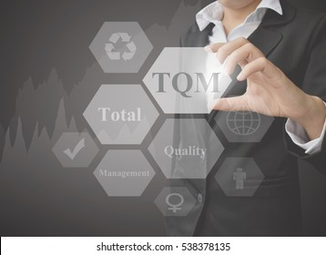 businesswoman showing presentation Total Quality Management on black background. concept for use in manufacturing(Training and Presentation)