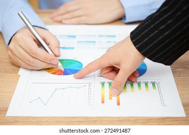 businesswoman showing sales report to his client