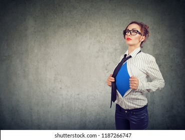 Businesswoman showing a super hero suit underneath her shirt