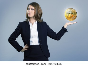 Businesswoman shows in the palm of bitcoin.