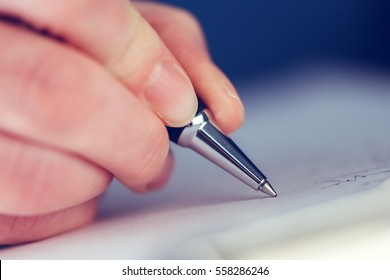 Businesswoman signing business contract agreement, close up of female hand with pencil writing signature