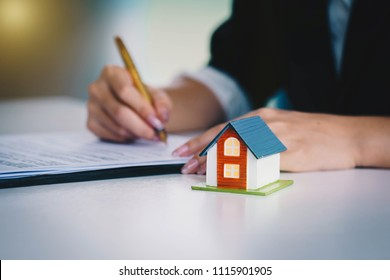Businesswoman signing the document contract  of a sale for a new house. Real estate services for buying your home. Loan for the purchase of housing.home loan and insurance concept.