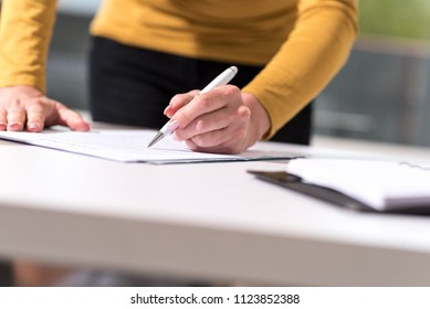 Businesswoman signing document in office