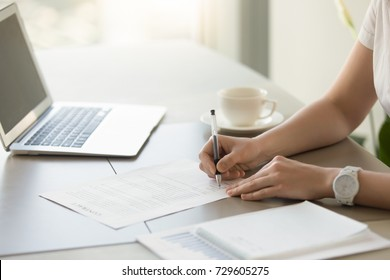 Businesswoman signing paper at workplace, company executive putting signature on official contract for work, supplies or services, female lawyer ratifying binding agreement by subscribing, close up
