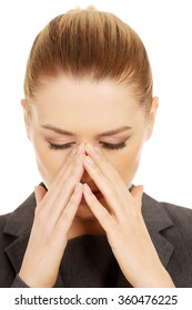 Businesswoman with sinus pain.