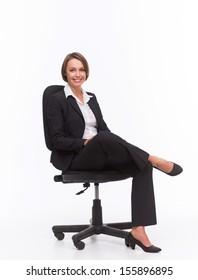 Businesswoman sit on chair isolated with white