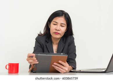 Businesswoman sitting at desk in office,