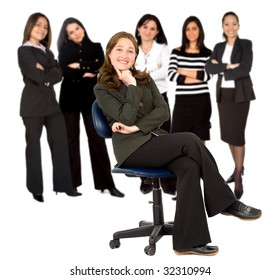 businesswoman sitting on a chair and her team behind her isolated
