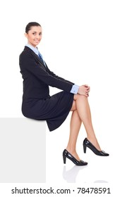 businesswoman sitting on horizontal banner edge,  smiling woman showing sign with lot of copy space, isolated on white background in full body