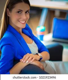 Businesswoman sitting on the sofa