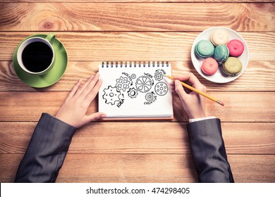 Businesswoman sketching in notepad