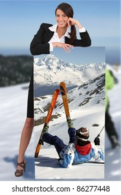 businesswoman at ski leaning on picture of herself printed on canvas