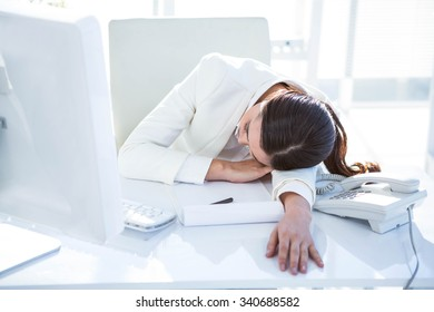 Businesswoman sleeping at the desk in work