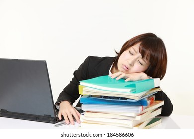 businesswoman Sleeping on the desk