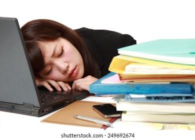 businesswoman sleeping on the desk
