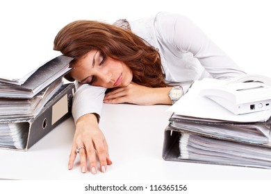 Businesswoman sleeping on working place