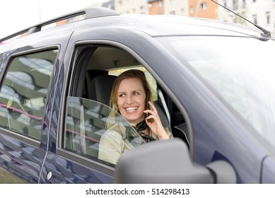 businesswoman with smartphone in the car