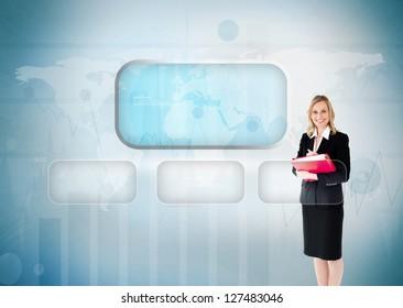 Businesswoman smiling near to a futuristic touchscreen