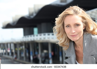 Businesswoman smiling outside airport