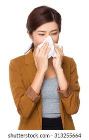 Businesswoman sneeze wnd feeling cold