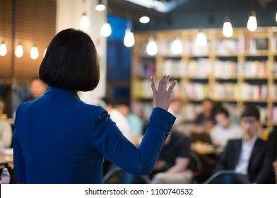 Businesswoman Speaker Speaking to Audience during Meeting. Business Conference Presentation Presenter