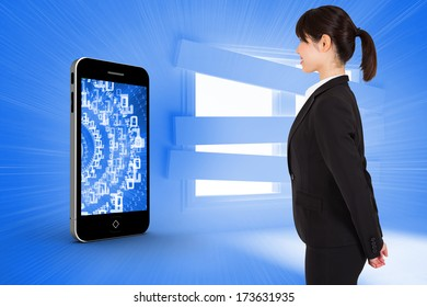 Businesswoman standing against bright blue room with bordered up window