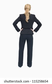 Businesswoman standing with back facing and hands on hip