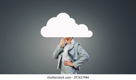 Businesswoman standing with cloud instead of head