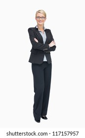 Businesswoman standing with folded arms while smiling