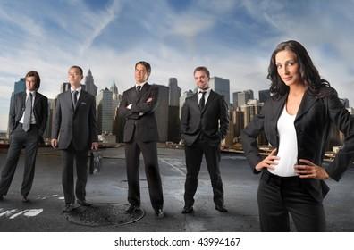 businesswoman standing in front of businessmen team