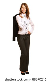 A businesswoman standing with a jacket on her shoulder, isolated on white