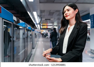 Businesswoman standing at the MRT