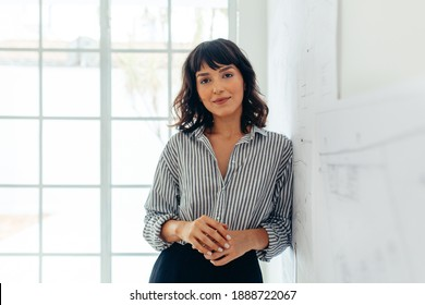 Businesswoman standing in office. Portrait of a confident businesswoman.