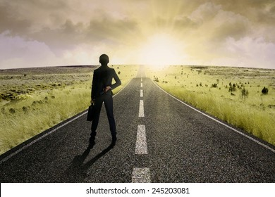 Businesswoman standing on the highway road, symbolizing as the way to the new opportunity