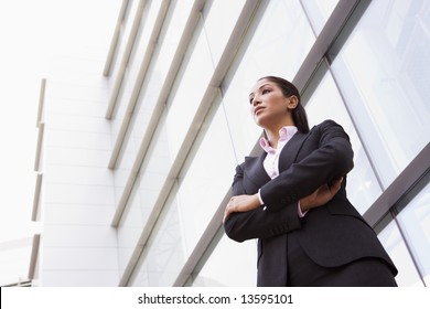 Businesswoman standing outside modern office building