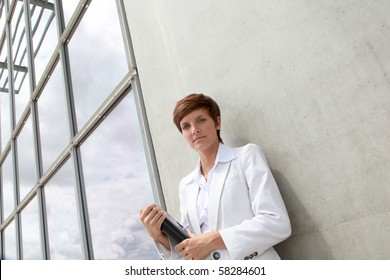 Businesswoman standing outside the office