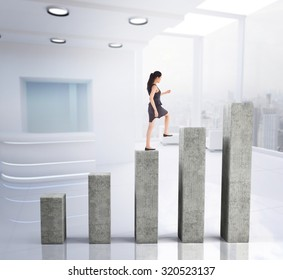 Businesswoman stepping up against bar chart depicting growth