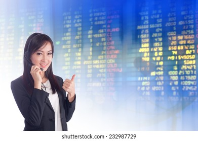 Businesswoman or stock broker ,stock exchange graph background.Woman Telemarketing Customer Service Agent Working in blur call center office Background.call center job concept.Positive emotion