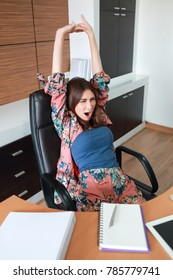 businesswoman stretch oneself and yawning