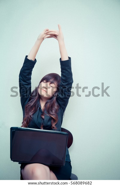 Businesswoman  stretching during working with her laptop. concept for business