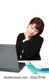 businesswoman suffers from neck ache
