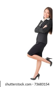Businesswoman in suit leaning on wall. Young Caucasian Asian professional woman isolated on white background