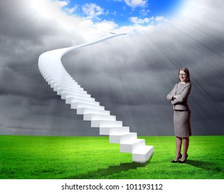 Businesswoman in suit standing near stairs going up