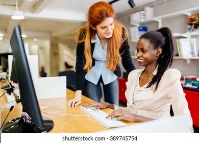 Businesswoman supervising employee in modern office