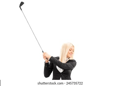Businesswoman swinging a golf club isolated on white background