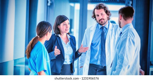Businesswoman talking with doctors in hospital