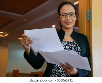 Businesswoman thinking about future business plan in front of the meeting room