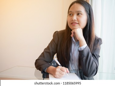 Businesswoman thinking about project in her officce