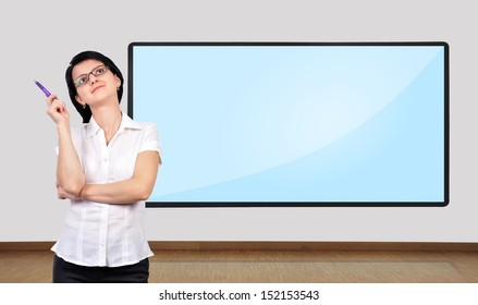 businesswoman thinking and big plasma on wall